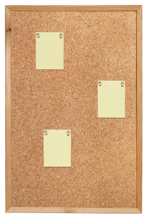 corked: Cork bulletin board with notes on slips of paper. Stock Photo