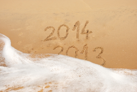 Year 2013 ends and 2014 begins tide in the sea. photo