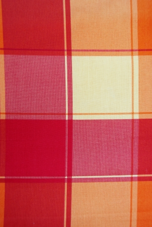 Cloth with red and orange dice, taken as a background. photo