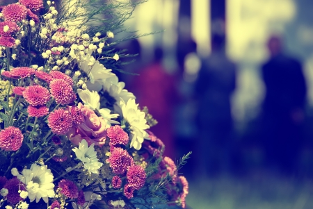 Bouquet of flowers at a funeral or wedding.