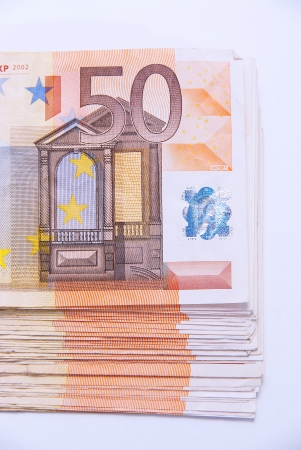 Euro banknotes photographed on a white background.