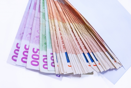 Different values of euro banknotes on a white background. photo
