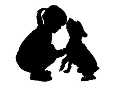 白い背景の上に犬を持つ子供のシルエット。
