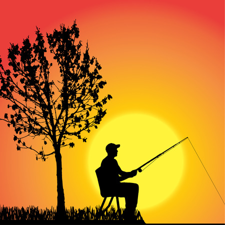 silhouette d'un homme qui pêche au coucher du soleil.
