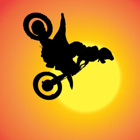 silhouette di estrema salta su una moto.