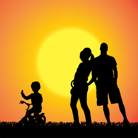 sundown: silhouette of a family that is out at sunset.