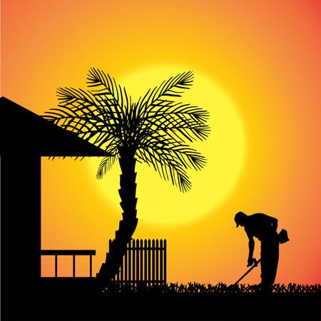 silhouette of a man work in front of the house.