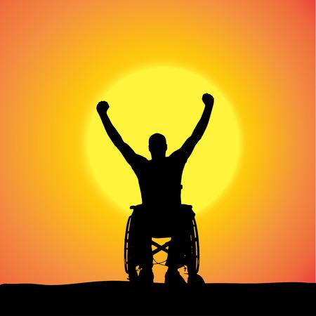 silhouetten van de man in een rolstoel bij zonsondergang.