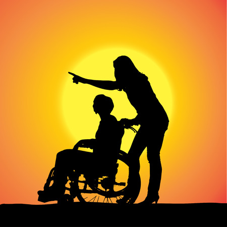 silhouettes of people in a wheelchair at sunset.  Vector