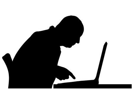 Vector silhouette of a man sitting at a computer on a white background. Vector
