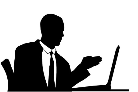 Vector silhouette of a businessman sitting at a computer on a white background. Vector