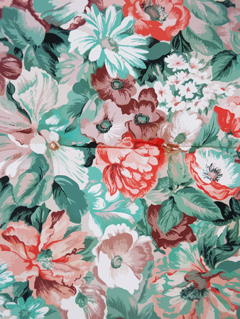 Vector background with colorful flowers and green leaves.