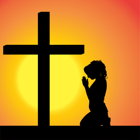 silhouettes of woman at the Cross at sunset.