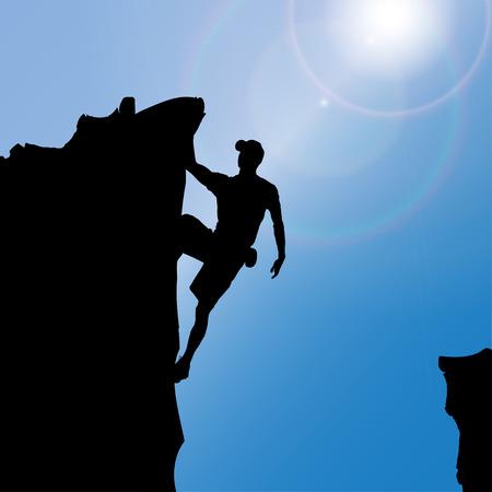 Silhouette eines Mannes, der Felsen klettert.