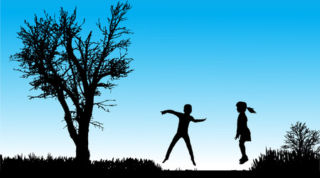 brother and sister: silhouette of children in nature along the beautiful days.