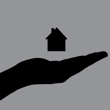 Vector silhouette of a hand with house on a white background. Vector