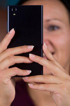 Woman make photo on cellphone. Stockfoto