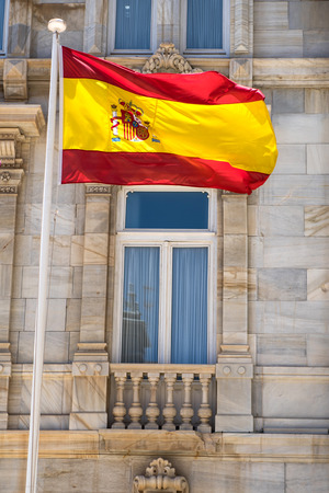 The flag of the Spain winding in the wind.