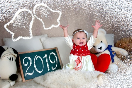 Little girl laughing and looking forward to Happy New Year 2019. Stockfoto