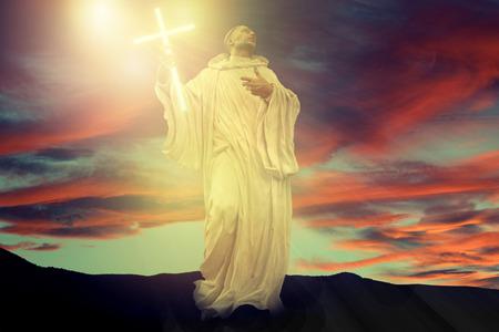 God phantasy holy statue with crucifix and dramatic sky. Banco de Imagens - 122031574