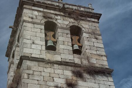The bell tower of an authentic Spanish curch mission. Europe church. Galicia Spain.