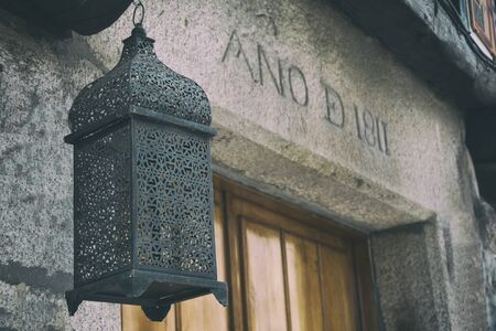Old stone house in europe with historic lamp, lantern. Galicia Spain. Stock Photo