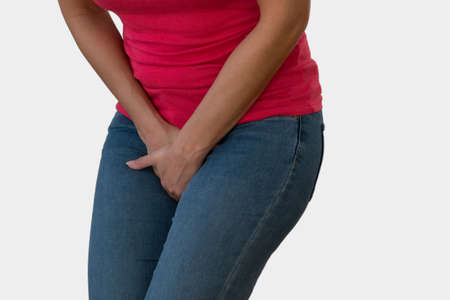Woman with Hands Holding her Crotch in White Background