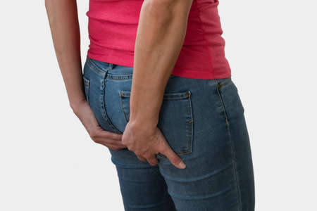 Woman with health problems. Hemorrhoids and intestinal issues.