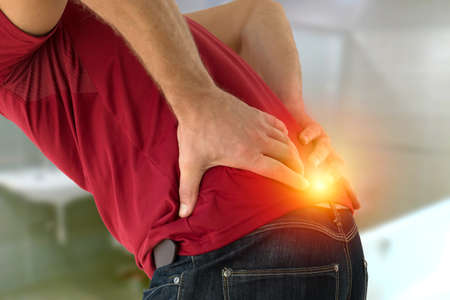 Health problem concept man suffering lower back pain.