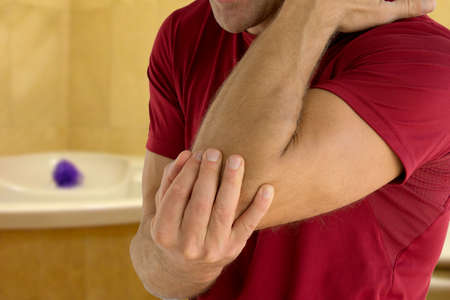 Health problem concept man suffering from elbow pain.