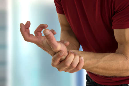 Health problem concept of man suffering from hand pain.