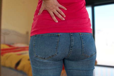 Woman suffering from backache, lower back pain. 版權商用圖片