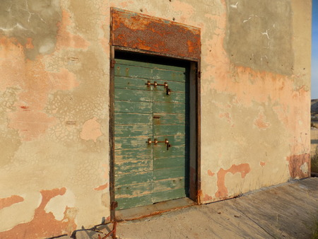 squalid: Old wall and old wood door Stock Photo