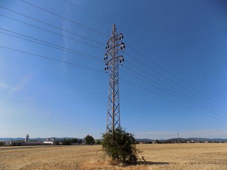 'power line': Power line column on field Stock Photo