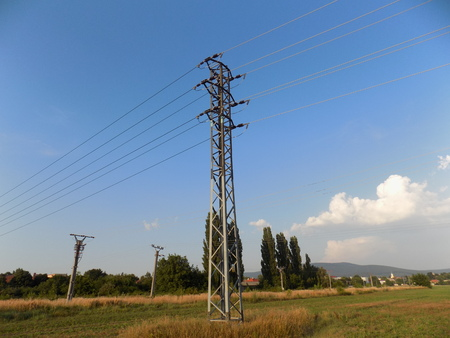 convective: Power line column on field Stock Photo