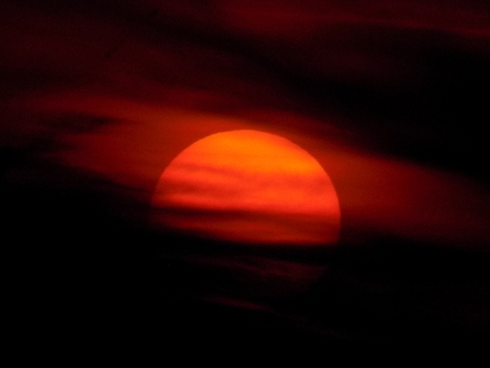obscuring: Clouds obscuring sunset Stock Photo