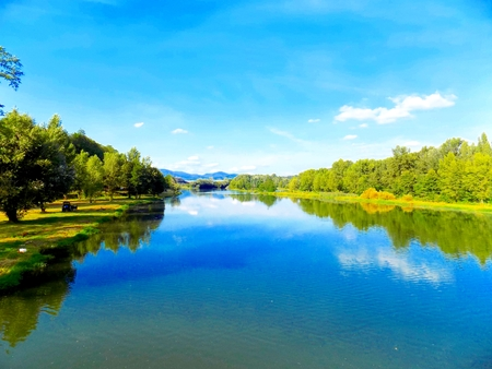 reflexion: Lake with reflexion, forest and sky Stock Photo