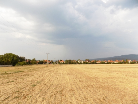 convection: Field after harvest, village and sky