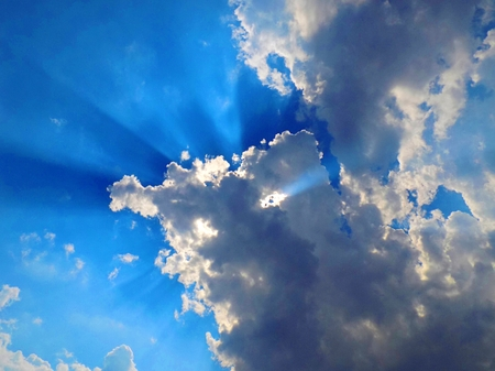convection: Sun behind the cumulus clouds