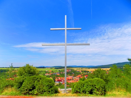 double cross: Double cross (Slovak national symbol) in front of village