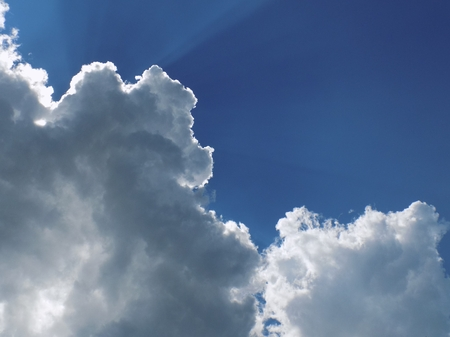 cumulus: Sun behind the cumulus clouds