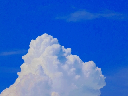 Cumulonimbus convective cloud indicating storm formation through low pressure system in unstable atmosphere during summer Stock Photo