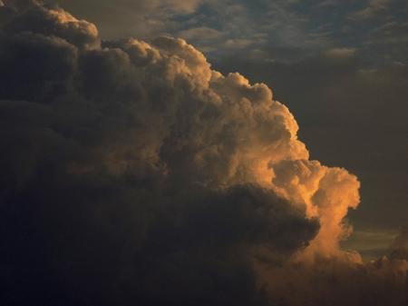cumulonimbus: Cumulonimbus convective cloud indicating storm formation through low pressure system in unstable atmosphere during summer during sunset