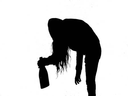 Silhouette of young alcoholic women with alcohol bottle, alcohol addiction