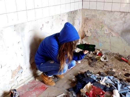 Young alcoholic women with alcohol bottle, alcohol addiction Lizenzfreie Bilder