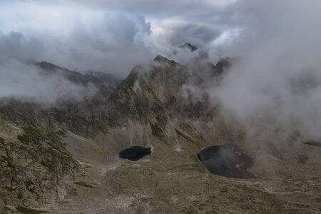 The two mountain lakes in the beautiful valley and mountains cover low clouds