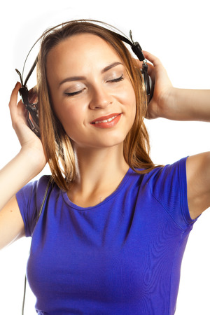 happy young woman listening music on white background