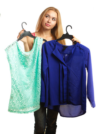 blouses: Woman keeps two blouses and cant choose the one for her isolated on white Stock Photo