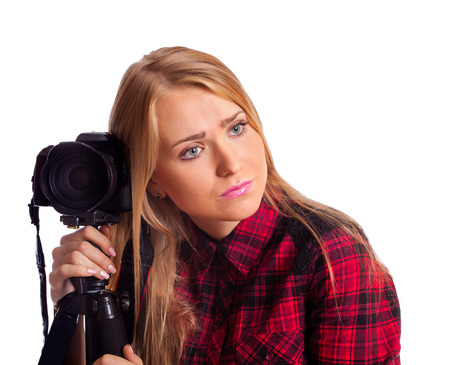 relying: Female photographer relying on tripod tired isolated over white