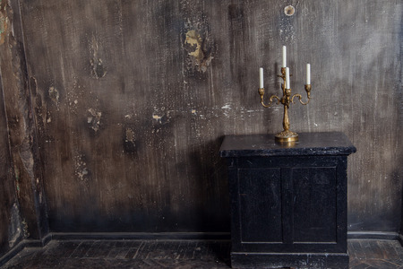 vintage furniture: Room with dark vintage textured wall and aged furniture
